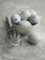 Eggs with a crown stamp in a bowl next to an egg whisk 22199080566| 写真素材・ストックフォト・画像・イラスト素材|アマナイメージズ