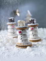 Snowmen made from PfeffernUesse (spiced soft gingerbread from Germany), biscuits and Dominosteine (chocolate covered sweets with