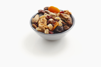 Assorted dried fruits and nuts in a bowl