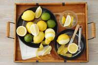 Lemons and limes (whole, cut in half, wedges and lemon peel) 22199080695  写真素材・ストックフォト・画像・イラスト素材 アマナイメージズ