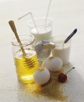 A still life of foodstuffs featuring honey, milk, yoghurt, eggs and brown sugar 22199080735| 写真素材・ストックフォト・画像・イラスト素材|アマナイメージズ