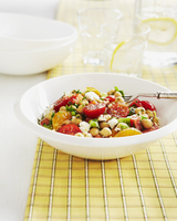 Tomato, Chickpea and Feta Cheese Salad in a White Bowl