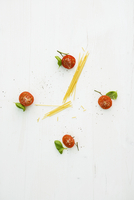 A clock face made from tomatoes, basil and spaghetti