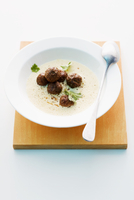 Cream of sweetcorn soup with meatballs