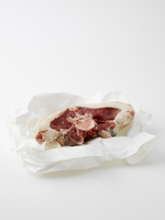 Bone-In Steak on Styrofoam Dish Wrapped in Plastic