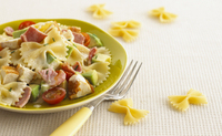 Pasta salad with avocado, tomatoes, ham and chicken