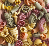 Pasta in assorted shapes and colours (filling the image)