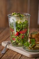 Rocket salad with tomatoes and mozzarella in a glass