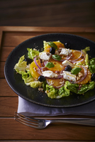 Orange salad with goat's cheese, olives and hazelnuts