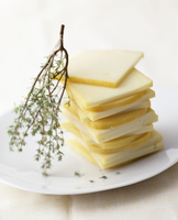 Raclette cheese, sliced, on a plate