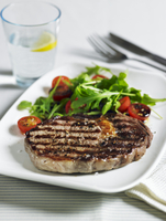 Beef steak with tomato and rocket salad