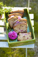 Yeast cake with rhubarb, in slices, on a garden chair