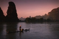 Bai fisherman and trained cormorants, Li River, Guangxi Prov