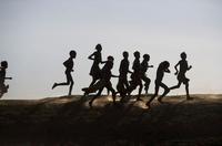 Silhouettes of Dassenech children running, Omo Delta, Ethiop