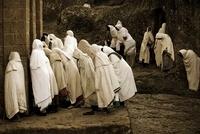 Pilgrims praying near the sunken churches of Lalibela, Ethio