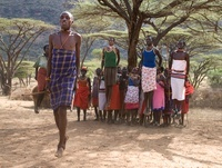 Samburu tribesman dancing to celebrate the mass circumcision