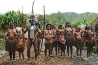 Dani tribespeople participating in traditional dance in thei