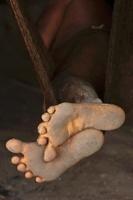Huaorani Indian's feet protruding form his hammock. Gabaro C
