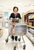 Woman Carrying Cart In Mart