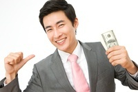 Young Businessman Holding Bills