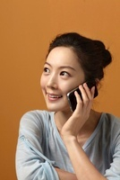Close-up of a young woman talking on the phone,Korean