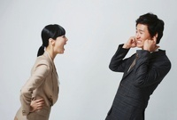 A young couple in business suits arguing,Korean