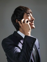 A young businessman holding an iPhone,Korean