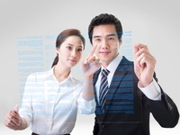 Businessman and a businesswoman Looking a File,Korean