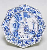 Chinese transition-style decorated plate in blue and manganese, ceramic, Nevers manufacture, Burgundy. France, 17th-18th century