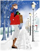 雪降る街角の女性