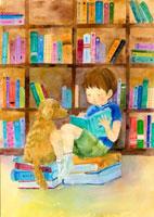 本を読む男の子と犬