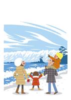 冬の海岸を散歩する家族