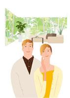 ブラインドのあるリビングの中年夫婦