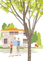 家の前の父母と女の子と手前の大きな木