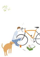自転車の整備する男性と散歩をせがむ犬