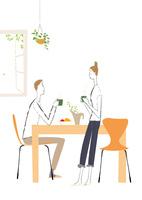 ダイニングテーブルでお茶を飲むカップル
