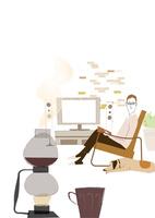 コーヒーの香りと読書する男性
