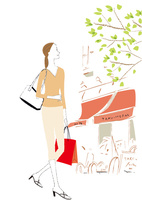 オープンカフェの前を歩く女性
