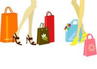二人の女性の足とショッピングバッグ