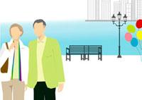 海沿いの公園を散歩するシニア夫婦