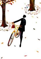 落ち葉の舞う道で自転車をおす女性