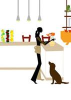 キッチンに花をかざる女性と見上げる犬