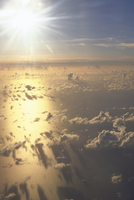 九州上空の雲上の太陽