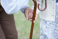 握っている手と杖