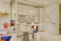 Kitchen and breakfast bar in show flat at V on Shenton condominium by UN Studio, Singapore.