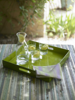 Water carafe and glasses on tray, France