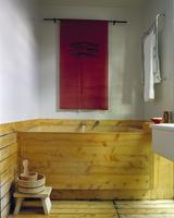 Wooden bathtub in white bathroom, New Zealand