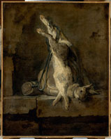 死んだウサギと狩りの道具