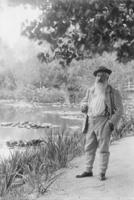 Monet pres du bassin aux Nympheas