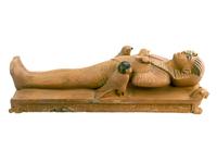 Statuette representant l'image du roi momiforme sur son lit